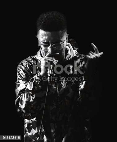 Rapper at a gig performing a song