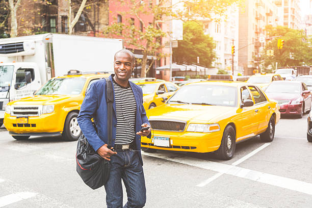 Black man crossing a street in New York. stock photo