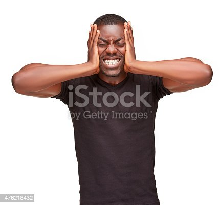 534891769 istock photo Black man holding his head in pain and depression 476218432