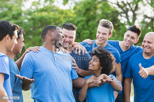 1091098220 istock photo Black man in group getting pat on back 596781018