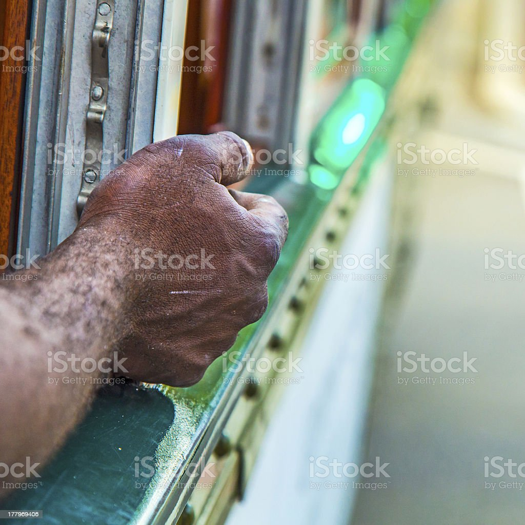 black man leans his arm out of the streetcar royalty-free stock photo