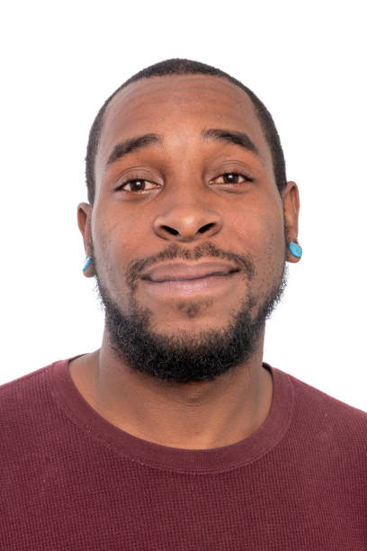 Black man looking at the camera on white background stock photo