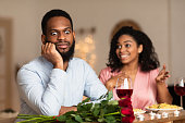istock Black Man On Unsuccessful First Date In Restaurant 1297777815