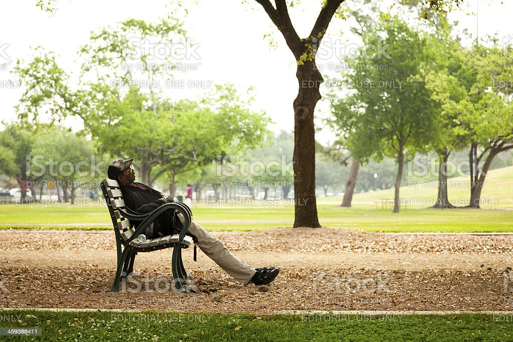 Black man resting on the bench stock photo