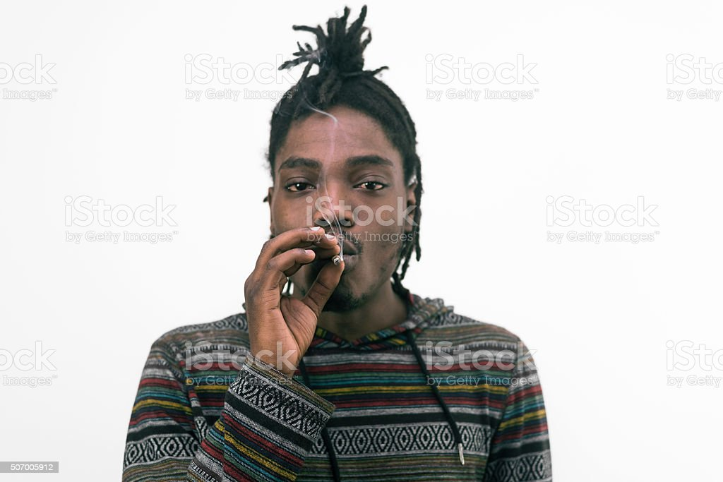 black man smoking cigar isolated on white stock photo