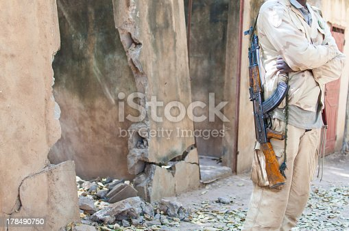 istock Black man stand with an AK 47 gun 178490750