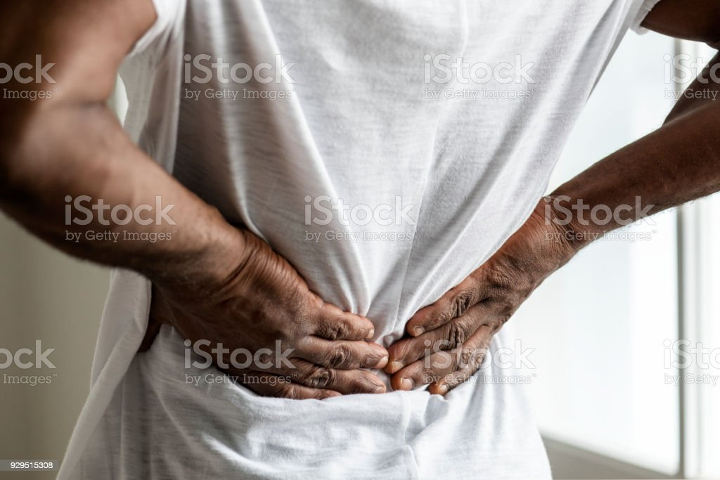 Black man suffering back pain stock photo