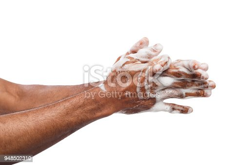 1182622704istockphoto Black man washing hands isolated on white background 948502310