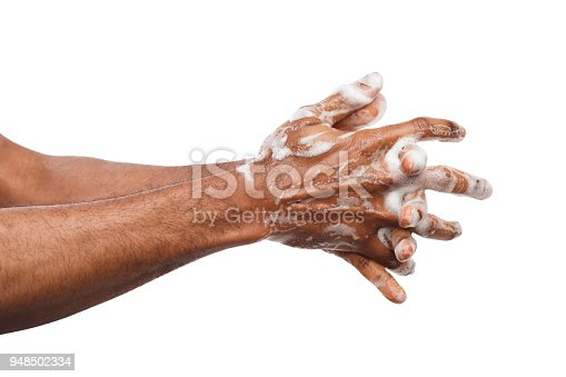 1182622704istockphoto Black man washing hands isolated on white background 948502334