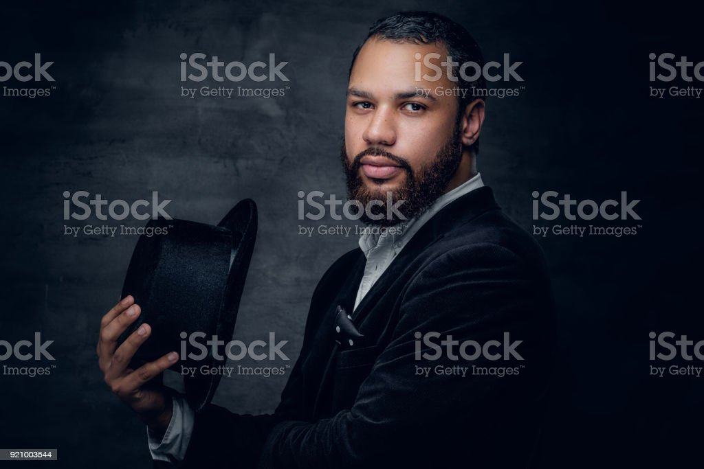 Black man wearing a suit and a felt hat. stock photo