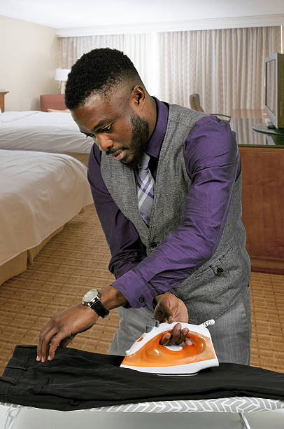 Black Man Ironing Clothes