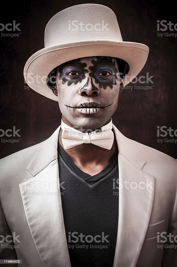 Black man with Sugar Skull makeup on his face (X) stock photo