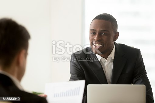 istock Black manager communicating with white client 843533940