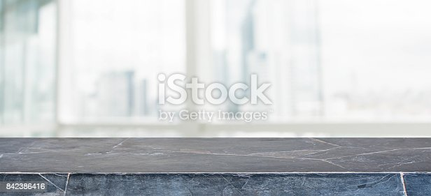 662984906istockphoto Black marble stone table top and blur glass window wall building with city view background - can used for display or montage your products. 842386416