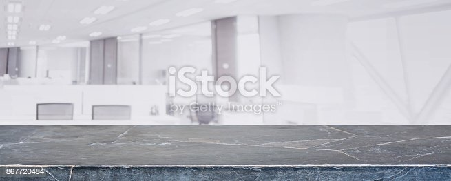 istock Black marble stone table top and blur glass window wall building with city view background - can used for display or montage your products. 867720484