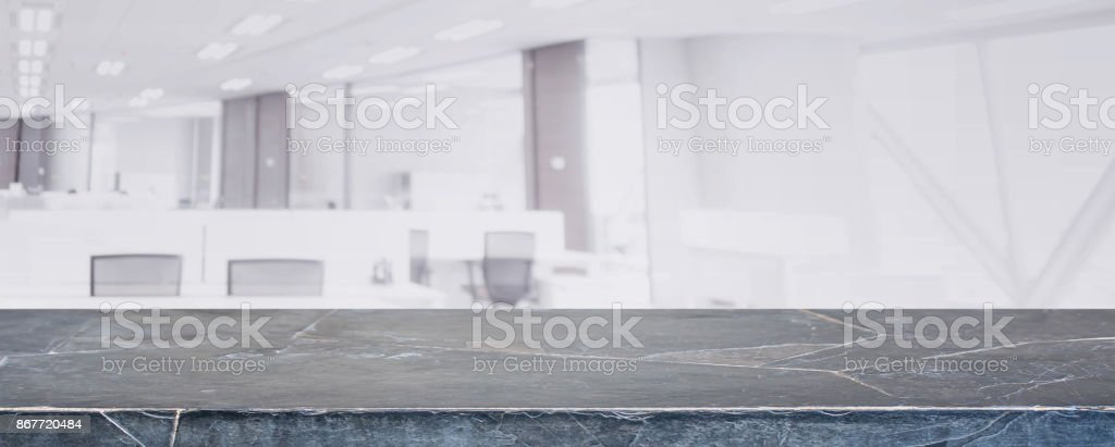 Black marble stone table top and blur glass window wall building with city view background - can used for display or montage your products. stock photo