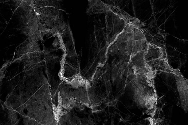 Black marble texture background in natural patterned. stock photo