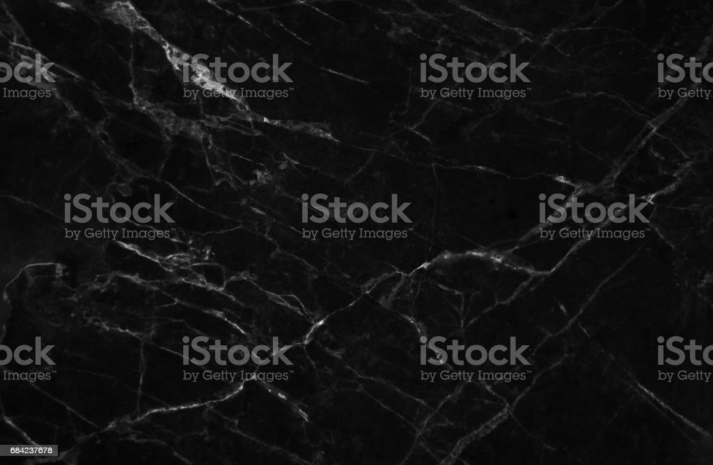 Black marble texture shot through with subtle white veining. royalty-free stock photo