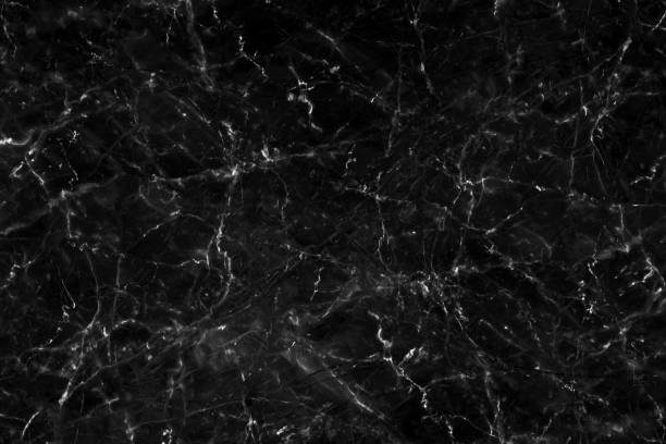 Black marble texture with natural pattern for background or design art work. Marble with high resolution stock photo