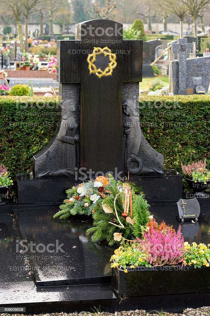 Black Marble tombstones in French cemetery stock photo