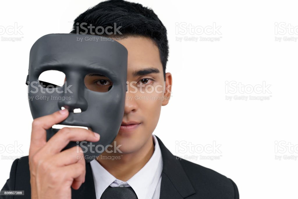 black mask with a young businessman wearing a suit, concept, spying or ambiguous stock photo