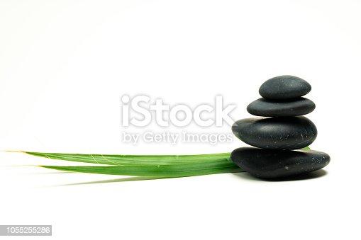 istock black massage stones and plants 1055255286