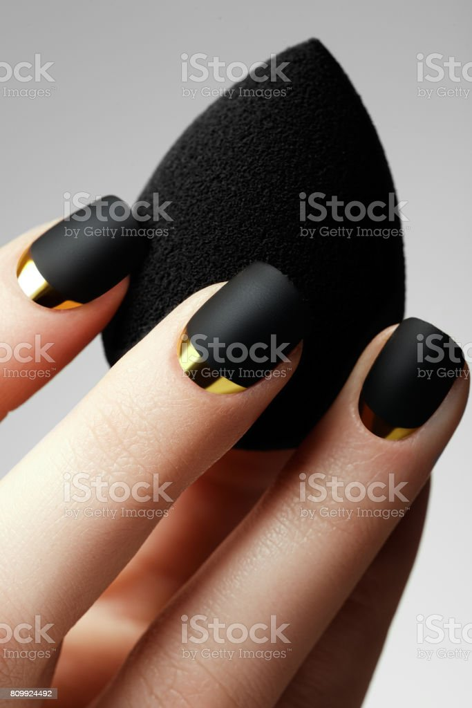 Black matte nail polish. Manicured nail with black matte nail p stock photo