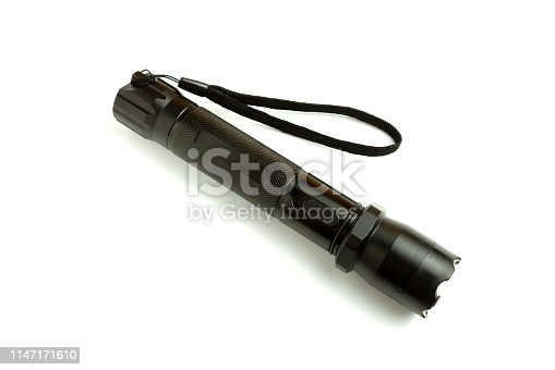 174913696 istock photo A black metal flashlight with shocker at the white background. protection and security concept. for design and decoration. 1147171610