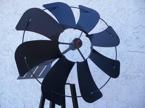 Black metal garden windmill stock photo