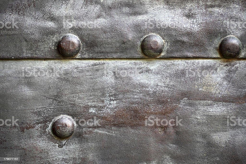 Black metal plate or armour texture with rivets royalty-free stock photo