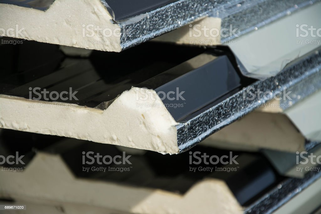 black metal sheet  roof with insulation attached under metal sheet. stock photo