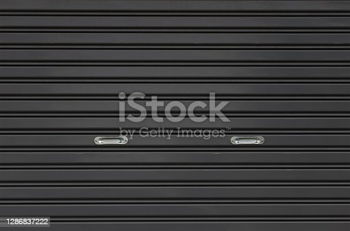 black metal shutter door with silver stainless holder.