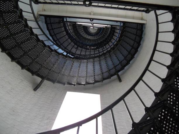 Black metal spiral staircase inside a tower stock photo