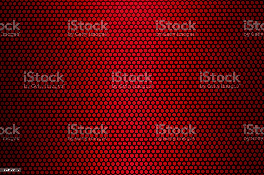 Black metal texture against red background stock photo