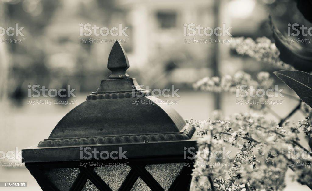 Black metallic lamp post isolated object photo stock photo