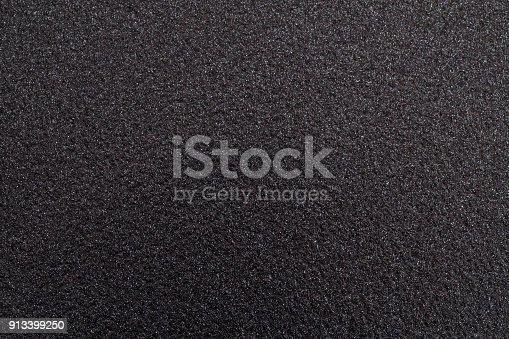 istock Black metallic textured sparkle background 913399250