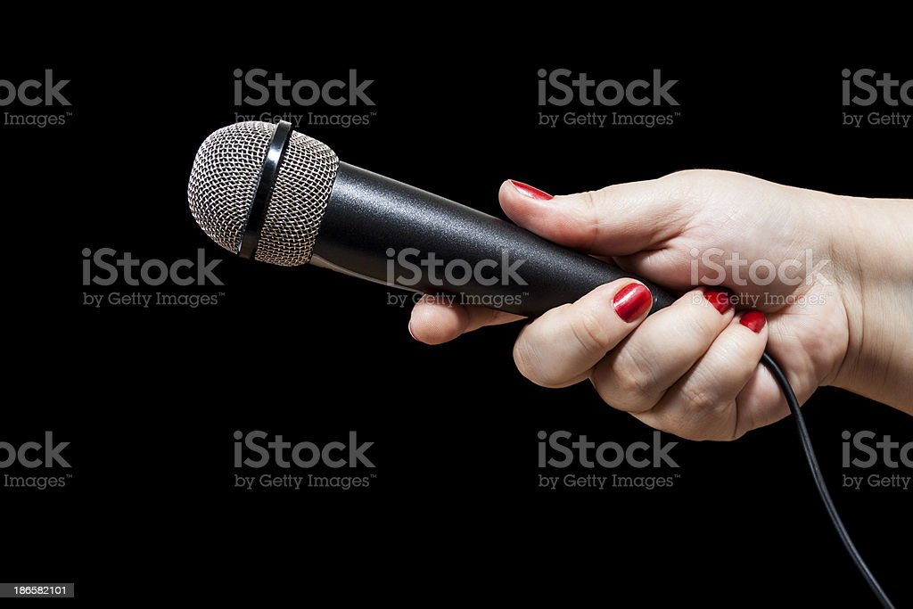 Black microphone in the hand royalty-free stock photo