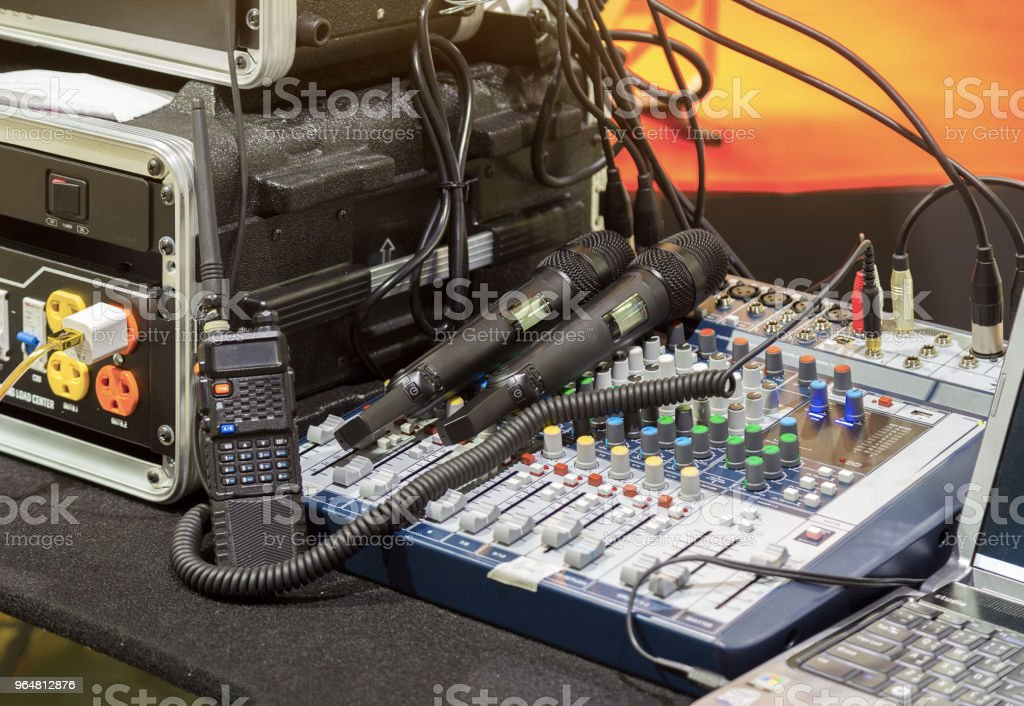 Black microphones, Walkie Talkie, sound mixer controller with knobs and sliders. stock photo