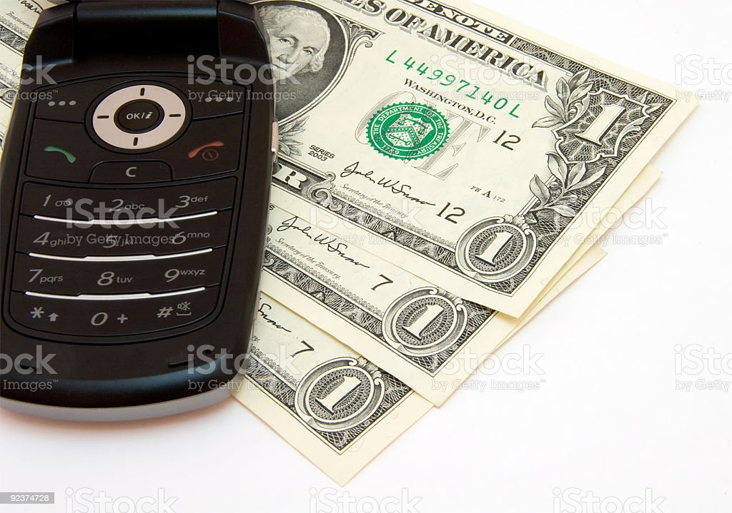 Black mobile phone and dollars stock photo