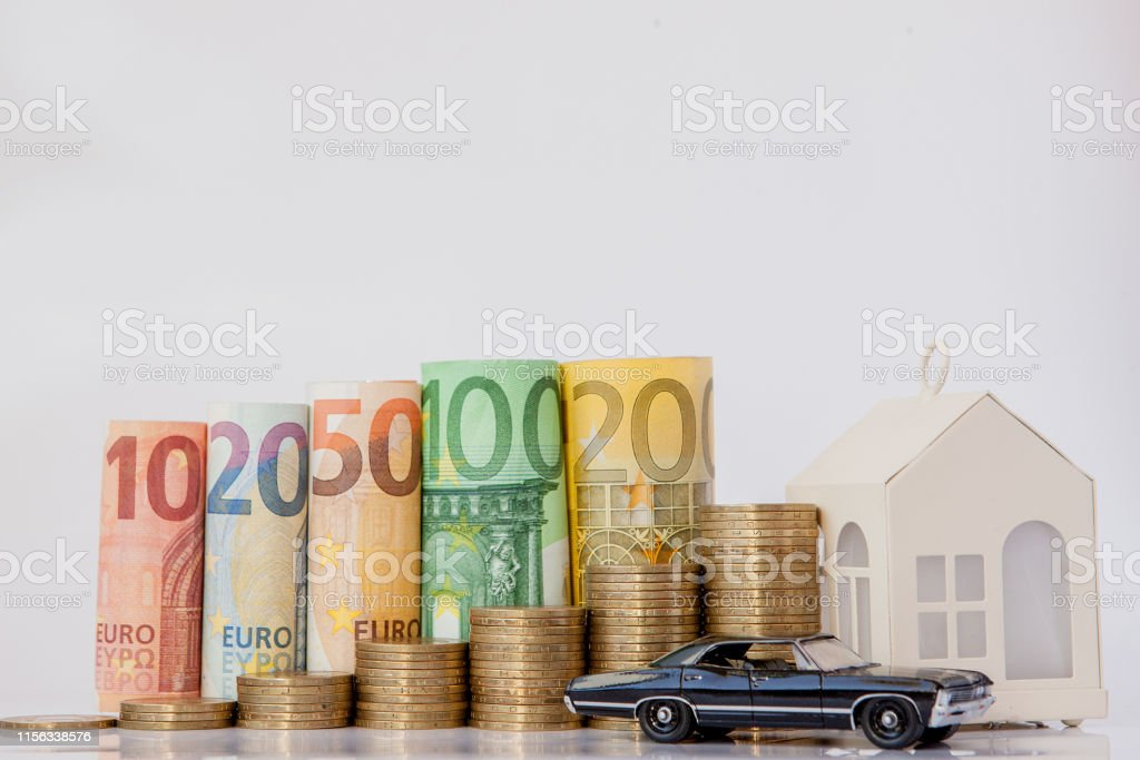 A black model of a car, house and ten, twenty, fifty, one hundred,...