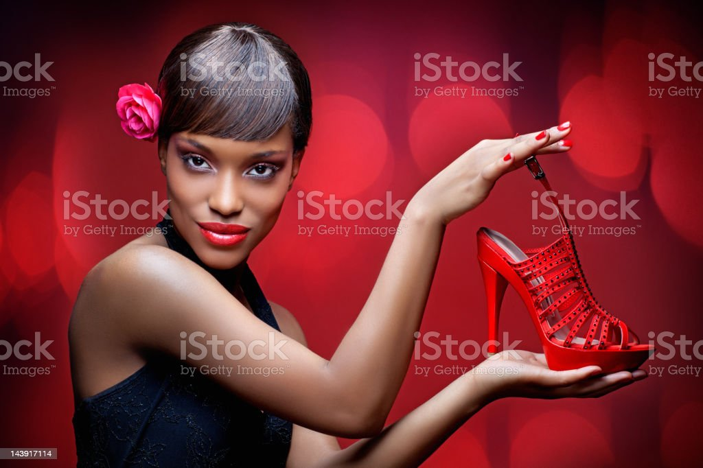 black model showing red shoe stock photo