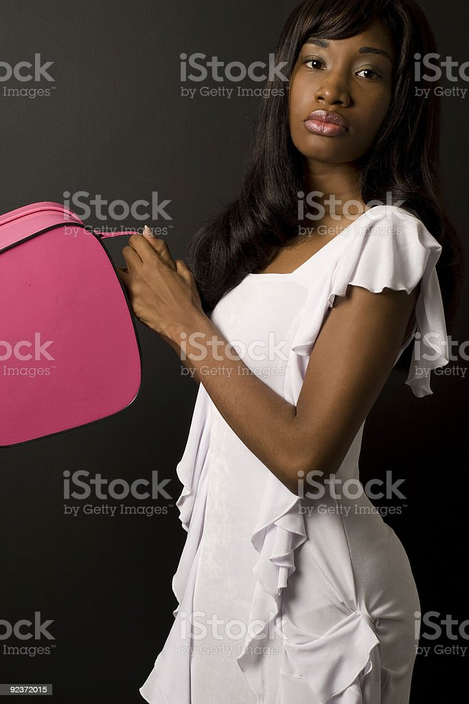 Black Model With Pink Purse royalty-free stock photo