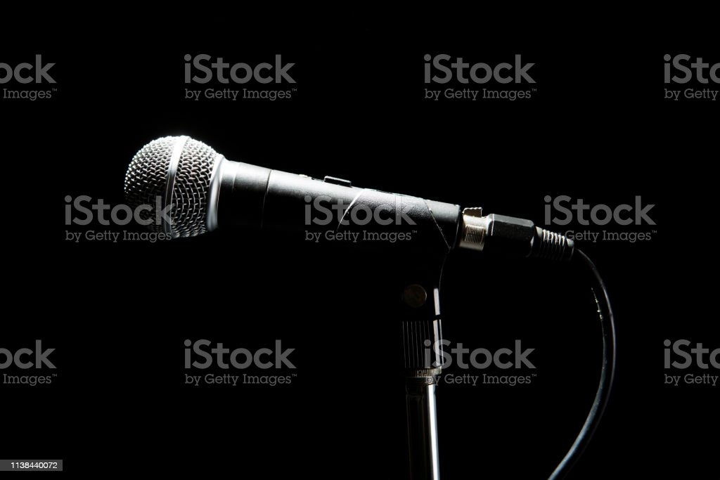 Black Modern Microphone On Stand Black Dark Background Accentuated Shapes With Light Stock Photo Download Image Now Istock