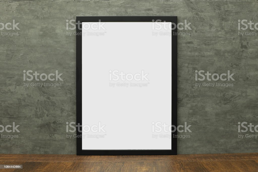 Black modern photo frame isolated on wooden table stock photo