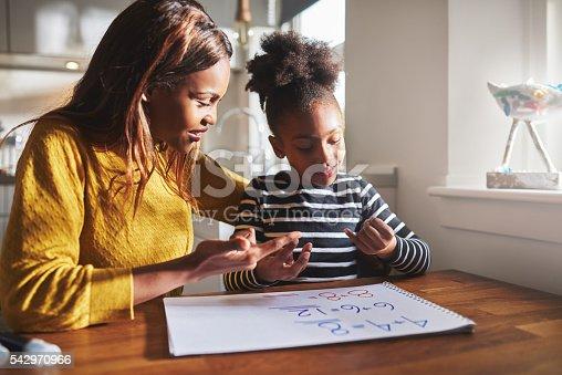 istock Black mom and child doing homework 542970966