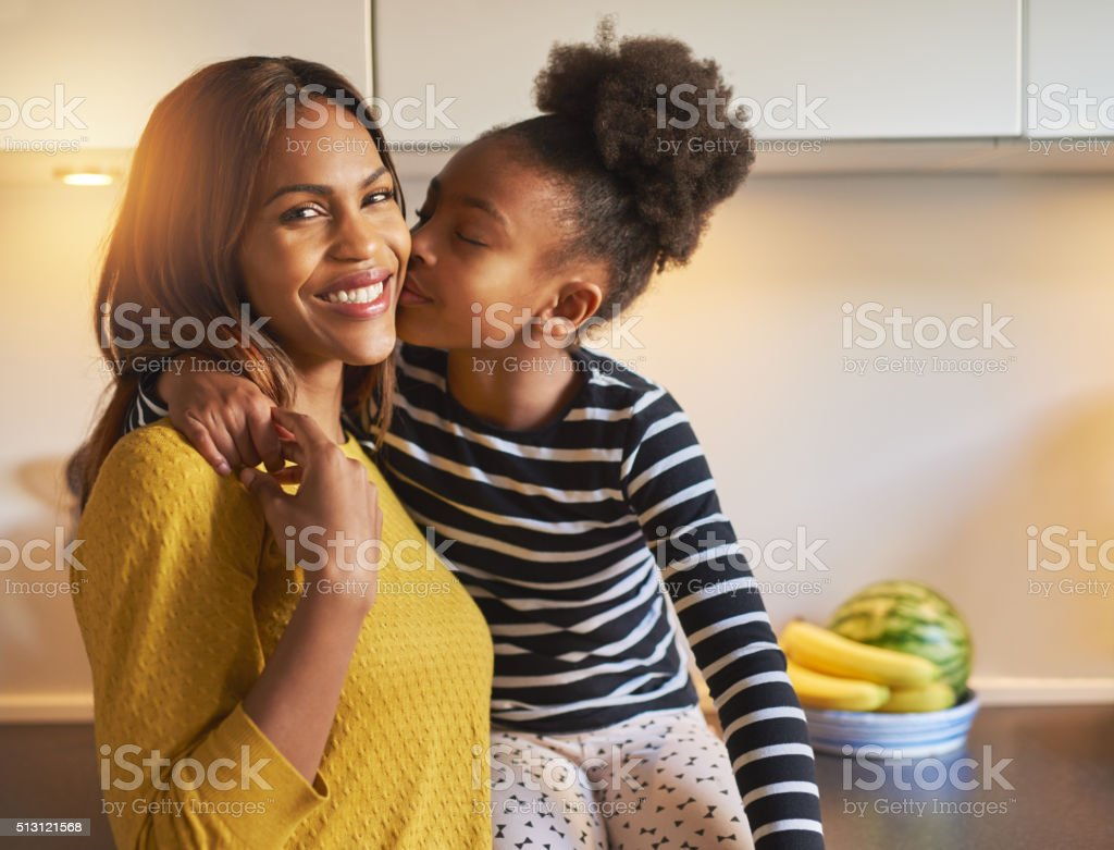Black mom and daughter loving each other stock photo