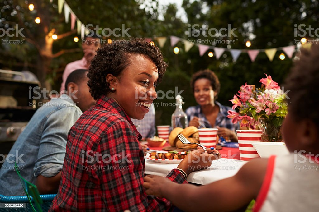 Black mother and son at family 4th July barbecue, stock photo