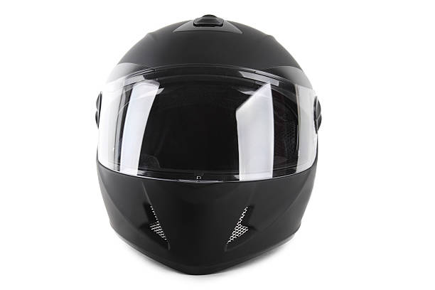 black motorcycle helmet isolated - helmet visor stock photos and pictures