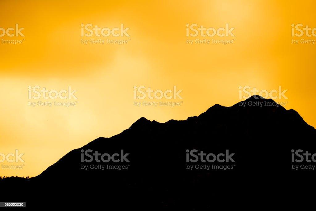 Black Mountain with orange sky background foto stock royalty-free
