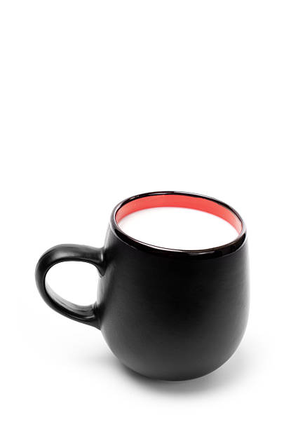Black mug with milk stock photo
